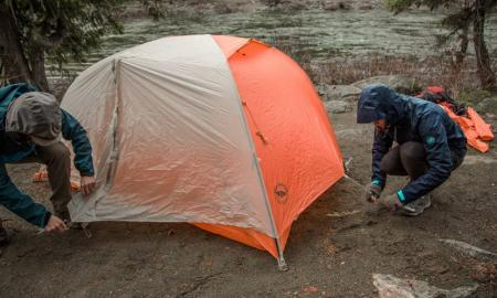 How do you set up a camping tent in the rain?